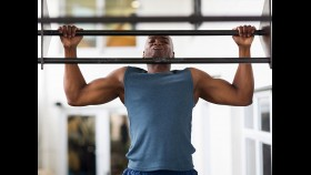 Man doing pullup at a gym thumbnail