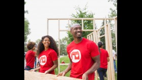 Volunteers Lift Construction Materials For Habitat For Humanity thumbnail