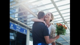 Couple Embrace at Airport thumbnail