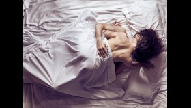 Couple Kissing in Bedroom thumbnail