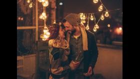 Couple Kiss During the Holidays thumbnail