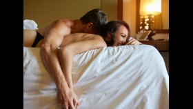 Couple cuddling on bed thumbnail