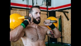 Man working out with two kettlebells  thumbnail