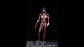 2014 Olympia - Tycie Coppett - Women's Physique thumbnail