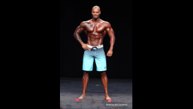 2014 Olympia - Tory Woodward - Mens Physique thumbnail