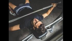 Man doing bench press exercise thumbnail