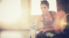 Woman Stretches During Her Workout thumbnail