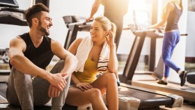 Man and woman flirting at gym thumbnail