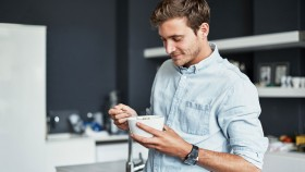 Man Eating a Bowl of Food thumbnail