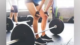 Woman Standing Over Barbell thumbnail