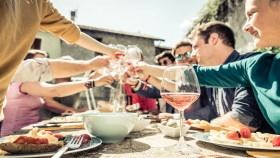 people drinking wine outside and toasting thumbnail