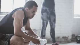 Tired man in gym with towel thumbnail