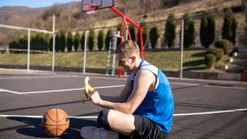 Basketball-Player-Eating-Banana-On-Outdoor-Court thumbnail