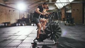 Man And Woman On Airdyne Bike At Gym thumbnail