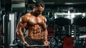 Bodybuilder performing biceps curl with barbell thumbnail