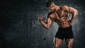Bodybuilder flexing bicep muscle thumbnail