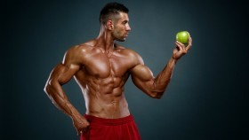 Bodybuilder holding apple thumbnail