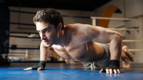 Boxer-Doing-Pushup-In-Boxing-Ring thumbnail