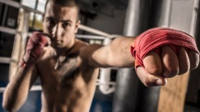 Boxer-Shadow-Boxing-With-Hands-Wrapped thumbnail