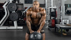 Brandon-Hendrickson-Posing-with-Medicine-Ball thumbnail