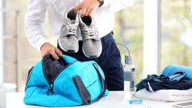 Business-Man-Packing-Gym-Bag-With-Sneakers thumbnail