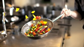 Chef-Tossing-Vegetables-In-Stainless-Steel-Pan thumbnail