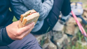 Couple-In-Workout-Gear-Male-Holding-Simple-Sandwich thumbnail