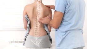 Crooked-Spine-Drawn-On-Back-Of-Patient-Doctor-Examination thumbnail