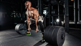 Man performing heavy deadlift at gym thumbnail