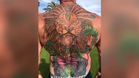 Six-time Mr. Olympia Dorian Yates shows off his new back tattoo.  thumbnail