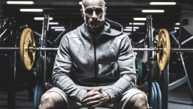 Dramatic-Man-Sitting-on-Bench-Press thumbnail