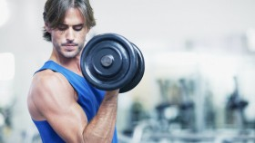 Man performing one-arm dumbbell curl thumbnail