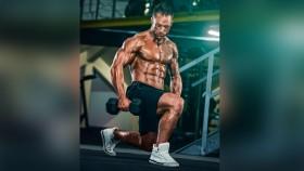 Bodybuilder performing dumbbell lunge thumbnail