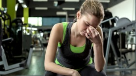 Female-Frustrated-Fitness-Gripping-Bridge-Nose thumbnail