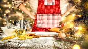 Female-In-Apron-Cooking-Baking-Christmas-Themed-Meal thumbnail