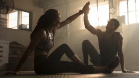 Fit-Couple-High-Fiving-In-Dark-Gym thumbnail