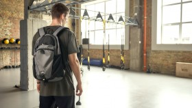 Fit-Person-Entering-Empty-Crossfit-Gym thumbnail