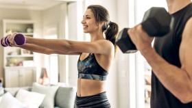 Fitness-Couple-Working-Out-At-Home-With-Dumbbells thumbnail