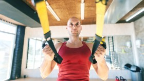 Focused-Bald-Man-Doing-TRX-Recline-Row thumbnail