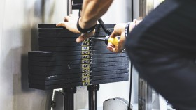 Stack of Weights o Machine at Gym thumbnail