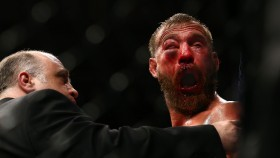 Donald Cerrone reacts after doctors call off his lightweight bout against Tony Ferguson during the UFC 238 event at United Center on June 8, 2019 in Chicago, Illinois. thumbnail