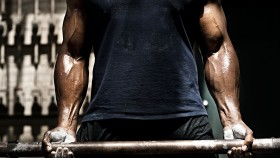 A man lifting weights.  thumbnail