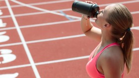 Girl-Drinking-Protein-Shake-On-Track thumbnail