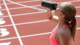 Girl-Drinking-Protein-Shake-On-Track thumbnail