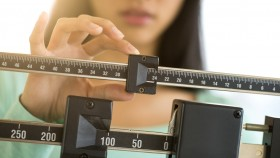 Girl-On-Scale-Adjusting-Weight thumbnail