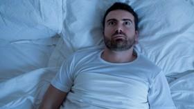 Guy-In-Bed-Awake-Trying-To Sleep thumbnail