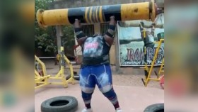 Powerlifter Iron Biby performing a log press.  thumbnail