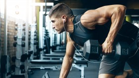 Man performing a single-arm dumbbell row on a bench thumbnail