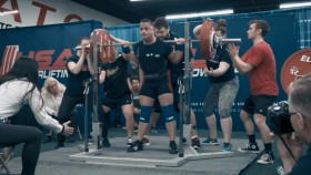 a competition back squat done in knee sleeves thumbnail