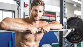 MUSCULAR-Man-leaning-against-barbell thumbnail